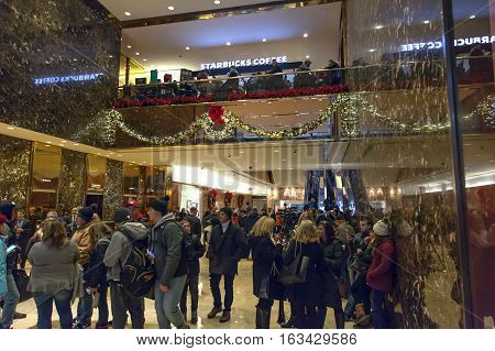 NEW YORK NEW YORK - DECEMBER 19: People visit Trump Tower on 56th street and 5th avenue in Manhattan. Taken December 19 2016 in New York City.