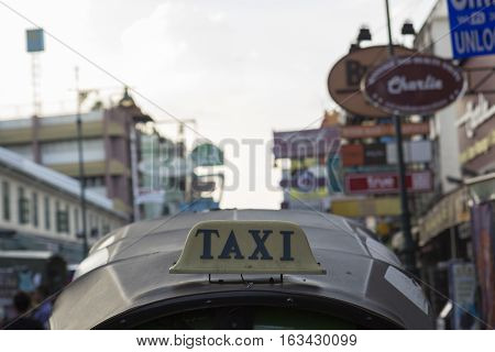 BANGKOK THAILAND - DEC 24 : taxi cab of tuktuk service car in Khao San road on december 24 2016. tuktuk is popular server for tourist in Bangkok.