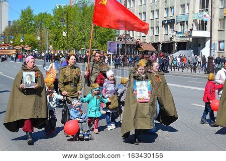 People in a military uniform with children participate in demonstration in honor of the Victory Day on May 9 2016. Tyumen Russia