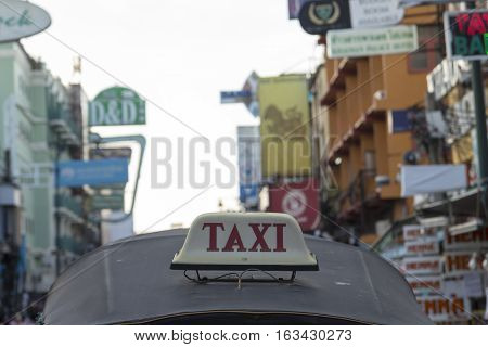BANGKOK THAILAND - DEC 24 : taxi cab of tuktuk taxi car in Khao San road on december 24 2016. tuktuk is popular server for tourist in Bangkok.