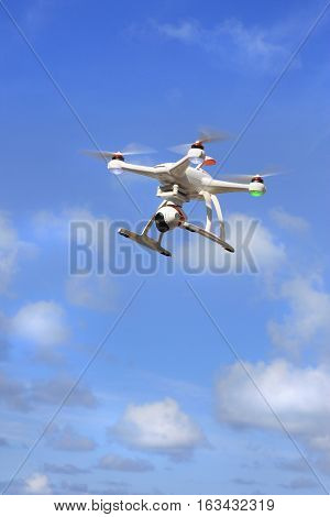 flying drone with camera and blue sky