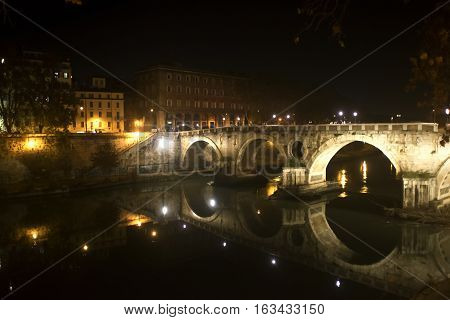Ponte sisto by night on the Tiber river in Rome