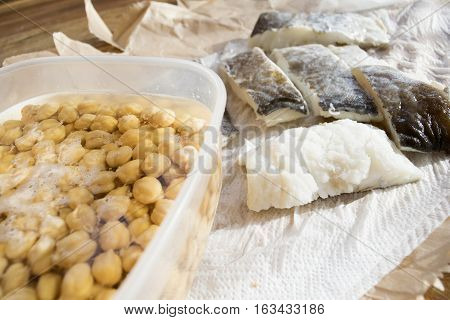 raw fillets of salted codfish with chickpeas in soaking