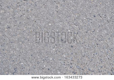 Detailed gray concrete sidewalk and rocks texture