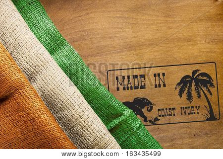 Industrial symbol of Made in the Coast Ivory and the country's flag.