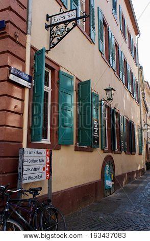 HEIDELBERG, GERMANY - MAR 29, 2014: Untere Street. Cosy cobblestone street.