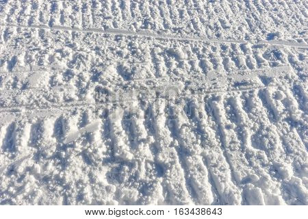 Snowmobile track marks on the snow, snow background