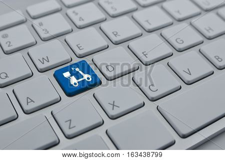Motor bike flat icon on modern computer keyboard button Internet business delivery service concept