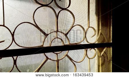 Steel cage curve bend stripes retro style on window Concept good morning memory of some life in old building house and shop of Bangkok Thailand.