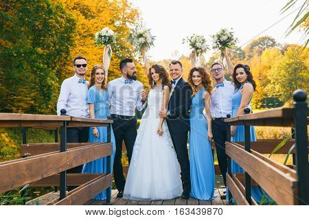 Groomsmen and bridesmaids with newly married on wedding ceremony