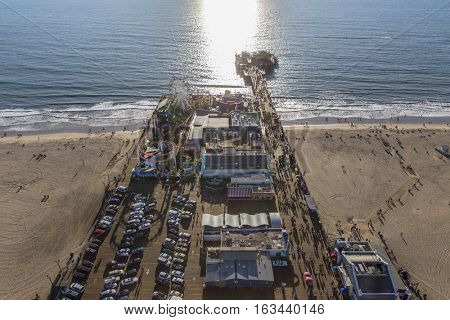 Santa Monica, California, USA - December 17, 2016:  Late afternoon aerial of Santa Monica Pier and the Pacific Ocean in Southern California.