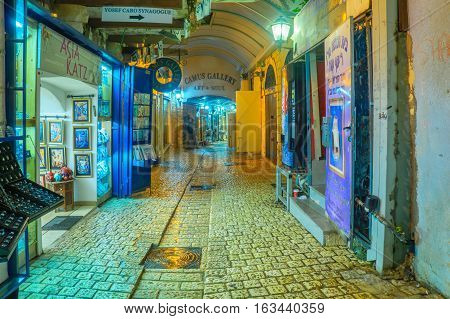 SAFED ISRAEL - DECEMBER 26 2016: An alley in the Jewish quarter with local shops and galleries in Safed (Tzfat) Israel.
