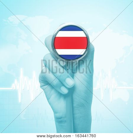 hand holding stethoscope with Costa Rica flag.