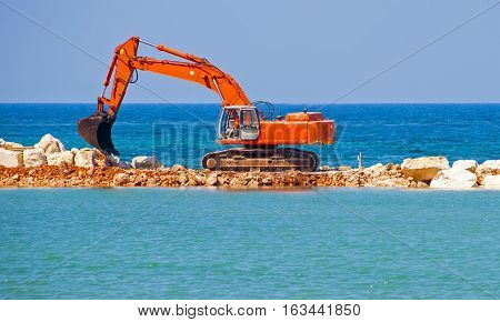 building the jetty with heavy excavator machine