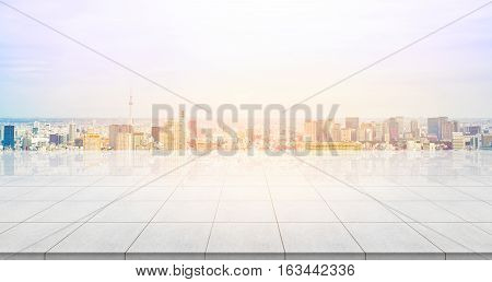Business concept - Empty concrete floor top with panoramic modern cityscape building bird eye aerial view under sunrise and morning blue bright sky of Tokyo skytree Japan for display or montage product
