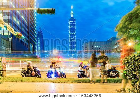 TAIPEI TAIWAN - NOVEMBER 19: This is a street view of downtown Xinyi district and Taipei 101 building at night time on November 19 2016 in Taipei