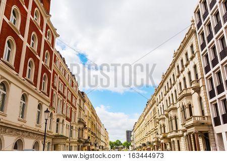 road with historic city buildings in Kensington London UK poster