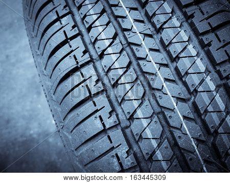 Close up shot of a new car tire.