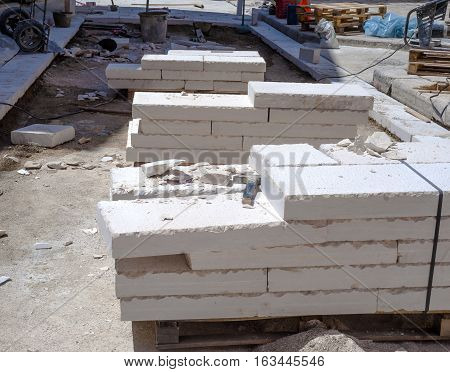 site area for the urban street pavement with limestone slabs. Featured pallets with limestone slabs work