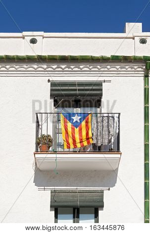 CADAQUES, SPAIN-OCTOBER 04, 2016: Banner of Catalan independence movement on a balcony