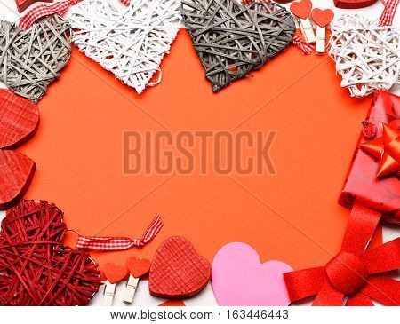 set of colorful decorative valentine hearts with checkered ribbon cute bow present or gift pegs on red background copy space