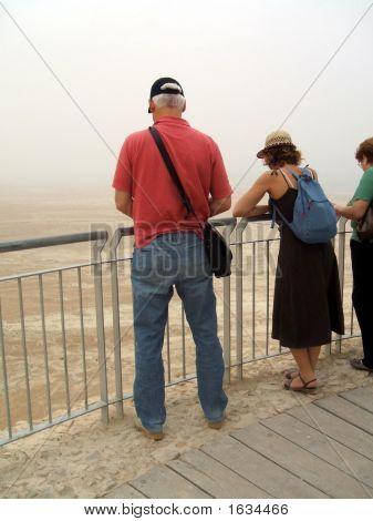 Tourists Looking Down At Massada Area