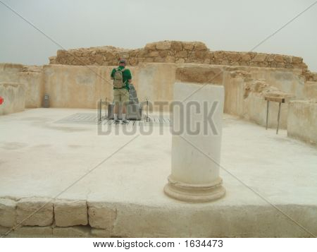 Tourist Looking At The Model Of King Herod'S Palace
