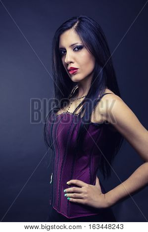 portrait of young brunette woman in bad mood, gothic style