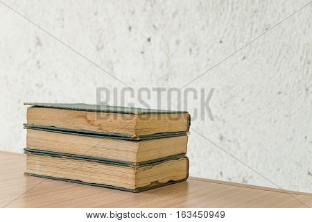 Bunch of vintage book on wooden table