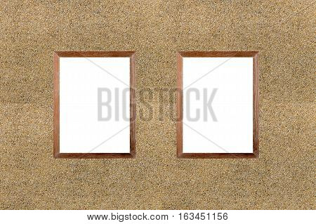 Blank wooden frame picture on Sand stone wall background.