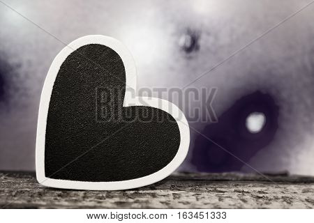 A black heart with white border photographed in black and white