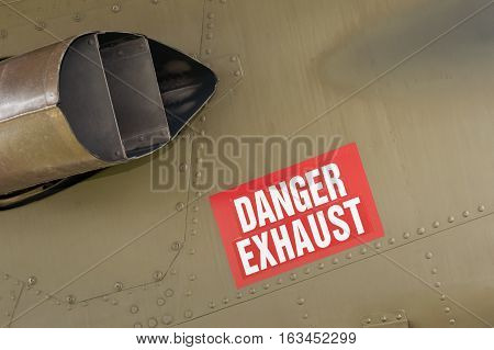 danger exhaust warning sign on an aircraft fuselage