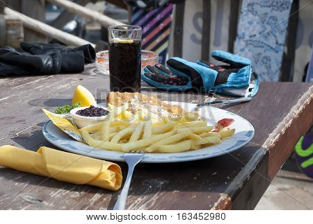 Lunch of mountain skiers in the Italian Alps in cafe on the mountain in Livigno.