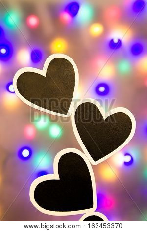 Some colorful lighted background with black hearts