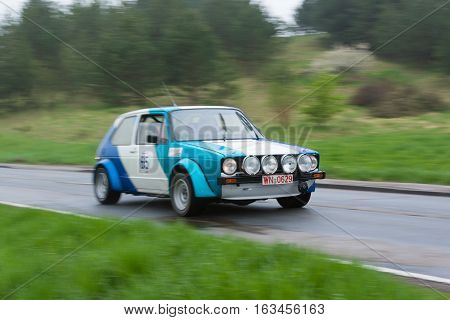 HEIDENHEIM GERMANY - MAY 3 2013: Hans Georg Erhardt and Wolfgang Schlenker in their 1980 Volkswagen Golf I at the ADAC Wurttemberg Historic Rallye 2013 on May 3 2013 in Heidenheim Germany.