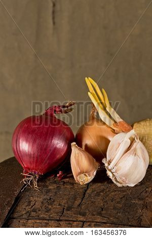 garlic and onion on the old wooden table
