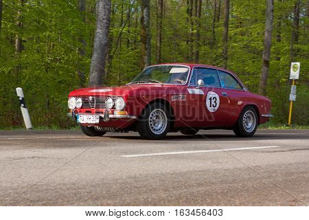 HEIDENHEIM GERMANY - MAY 4 2013: Frank Hecht and Sarah Janina Wurth in their 1972 Alfa Romeo GTV 2000 at the ADAC Wurttemberg Historic Rallye 2013 on May 4 2013 in Heidenheim Germany.