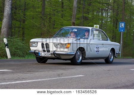 HEIDENHEIM GERMANY - MAY 4 2013: Sabine Lauer and Ursula Lauer in their 1966 BMW 2000 CS at the ADAC Wurttemberg Historic Rallye 2013 on May 4 2013 in Heidenheim Germany.
