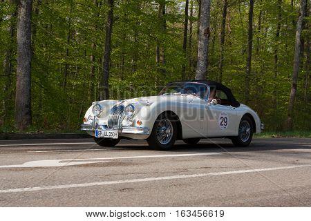 HEIDENHEIM GERMANY - MAY 4 2013: Ulrich Kleinle and Werner Kleinle in their 1958 Jaguar XK 150 S at the ADAC Wurttemberg Historic Rallye 2013 on May 4 2013 in Heidenheim Germany.