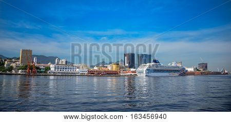 View of the transatlantic cruise liner standing in the port of Rio de Janeiro located in a cove on the west shore of Guanabara Bay at sunny day, RJ, Brazil