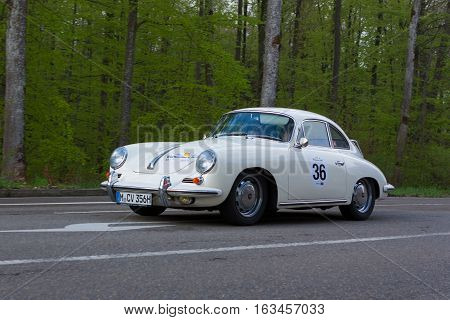 HEIDENHEIM GERMANY - MAY 4 2013: Dr. Thomas Strieder and Thomas Heinze in their 1965 Porsche 356 Coupe at the ADAC Wurttemberg Historic Rallye 2013 on May 4 2013 in Heidenheim Germany.