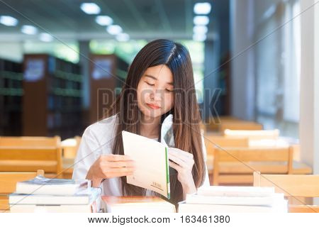 Happy Student Women Sittng On Wood Chair Light From Window For Reading Books