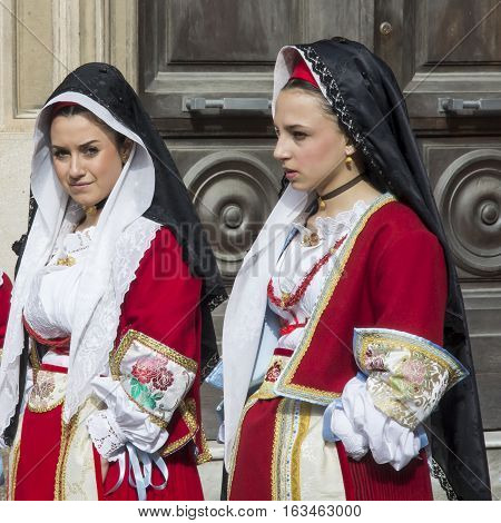 CAGLIARI, ITALY - May 1, 2013: 357 Religious Procession of Sant'Efisio - Sardinia - portrait of beautiful girls in traditional Sardinian costume