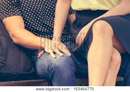 Love romance flirt dating concept. Girl sitting on boyfriends lap. Young lady showing affection to her man.