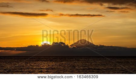 Sunset landscape with panoramic view to Bali and Agung Volcano mountain taken from Lombok Island Indonesia