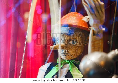 wooden toy of Pinocchio puppet like background