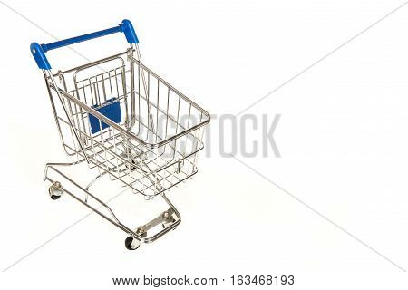 Empty shopping pushcart seen from above with room for text on a white background