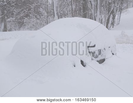 a car buried under a ton of snow