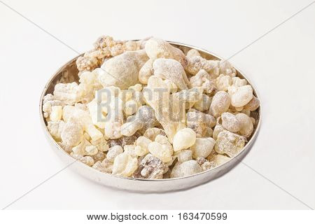Frankincense in a plate, isolated in the white background