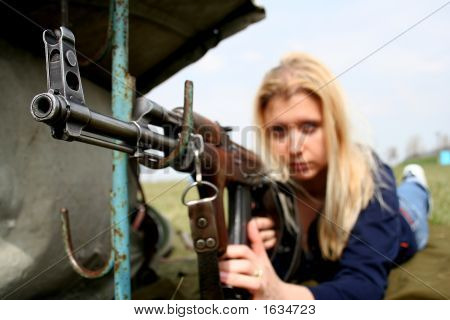 Woman With Machine Gun
